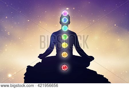Chakras And Meditating Men In Yoga Lotus Position. Mindfulness And Self Awereness Practice. Silhiuet