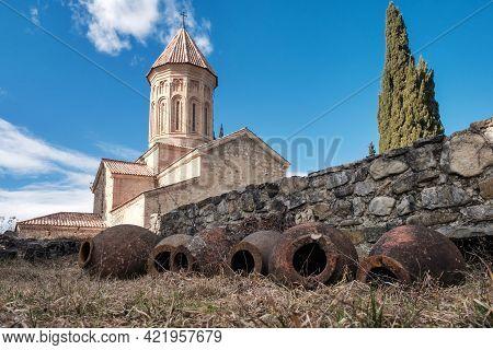 Qvevri, Georgian Traditional Jug For Wine Making Near The Stone Wall At Monastery