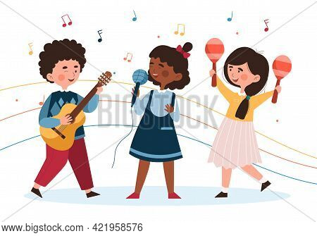 Three Little Diverse Girls Are Singing Together And Boy Is Playing Guitar On Stage. Concept Of Kids