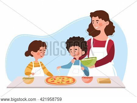 Young Mother Is Helping Little Son And Daughter To Cook Pizza In The Kitchen. Smiling Mom Helps To P
