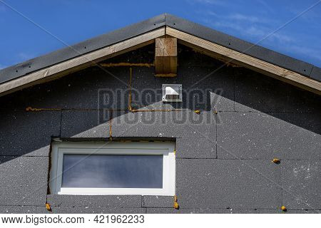 A Plastic Ventilation Grille On The Facade Of The Building Made Of Black Insulating Polystyrene, Pla