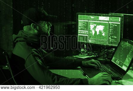 Hackers breaking server using computers. Cybercrime concept.