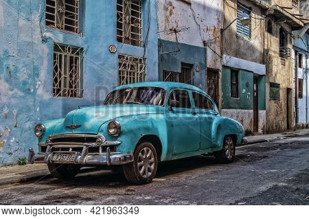 Havana, Cuba, July 2019, View Of A Light Blue Classic American Car Parked In A Street In The Old Par