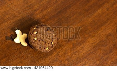 Tasty Chacolate Cookies Was Shot At My Home Using Tungsten Light Source On A Wooden Table. Very Tast