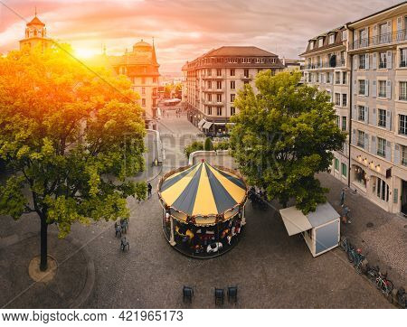 Carousel in the Old Town, Geneva,  Beautiful Sunrise Over Geneva Old City,  Skyline View,  Switzerland