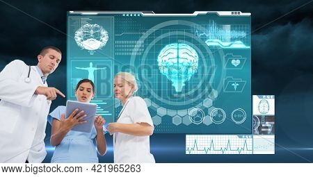 Composition of male and female doctors using tablet with medical research data interface screen. global medicine, research and digital interface concept digitally generated image.