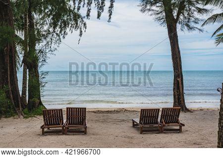 Wooden Chair Beside The Beach With Beautiful Idyllic Seascape View On Kohkood Island.koh Kood, Also