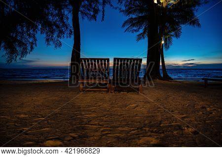 Wooden Chair Beside The Beach With Beautiful Idyllic Seascape Sunset View On Kohkood Island.koh Kood