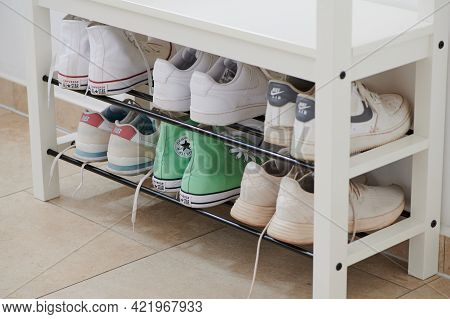 Mainz, Germany - May 22, 2021: Sports Shoes With Nike And Converse Of A Family On The Shelf In The H