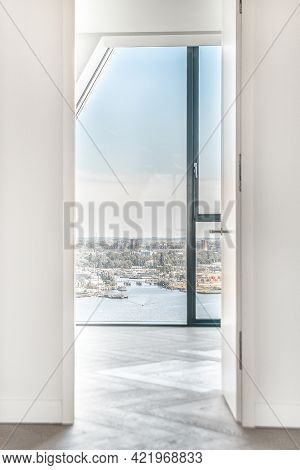 Doorway In Apartment Penthouse With Wooden Parquet Flooring And Wall Windows Viewing City
