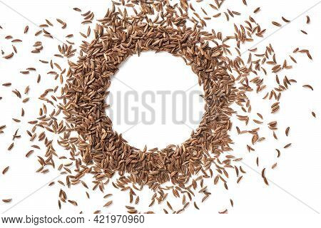 Close Up Caraway Seeds. Dried Caraway Seeds Isolated On White Background. Pile Of Cumin Seeds. Seaso