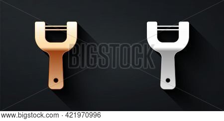 Gold And Silver Vegetable Peeler Icon Isolated On Black Background. Knife For Cleaning Of Vegetables