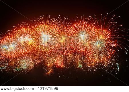 Beautiful Firework At Night. Red Colored Burst On Black Sky. Light Trace With Bright Burst And Spark