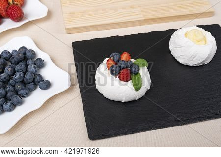 Top View Meringue Cake With Fresh Strawberry And Blueberry. Cake Anna Pavlova