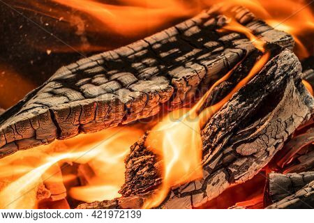 A Blazing Fire In The Dark. Ignition Of Wood In The Fire. A Bright Burning Flame. Sparks And Flames