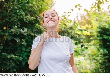 Young Woman Smiling Outdoor. Beautiful Brunete Girl Resting On Park Or Garden Green Background. Free
