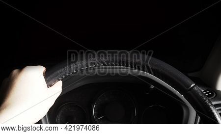 Steering Wheel And Man Hand. Black Leather Modern Car Interior Close Up.
