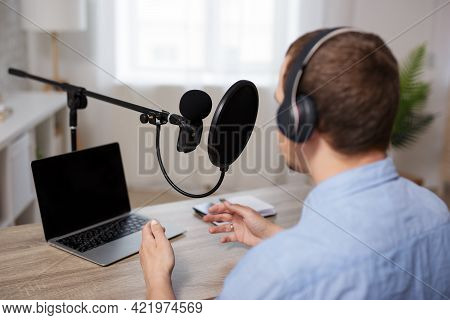 Radio, Podcast And Audio Blog Concept - Back View Of Male Blogger Or Journalist Recording Audio Podc