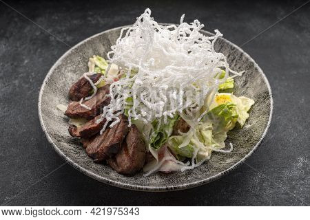 Salad With Veal, Tomatoes, Eggs On A Plate