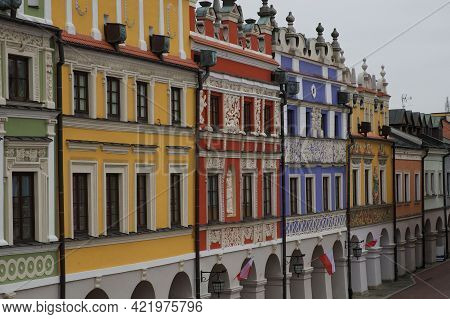 Richly Decorated Old Renaissance Houses In The Polish Town Of Zamosc. Colorful Old European Houses,