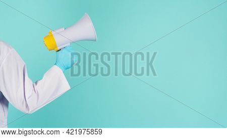 Megaphone In Hand.man Wear Doctor Gown And Blue Medical Glove On Mint Green Or Tiffany Blue  Backgro