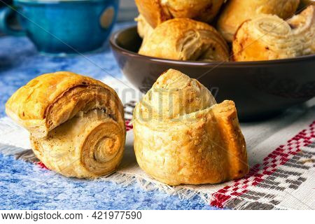 Fresh homemade puff pastry rolls baked with cinnamon.
