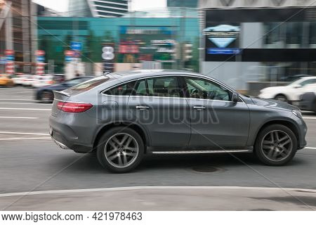 Moscow , Russia - April 2021: Gray Mercedes-benz Gle Suv Coupe Car Moving On The Street