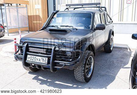 Samara, Russia - May 15, 2021: Tuned Lada 2329 Vehicle With All Terrain Tires. Black Tuned All Terra