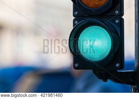 Closeup Of Traffic Semaphore With Green Light On Defocused City Street Background With Copy Space