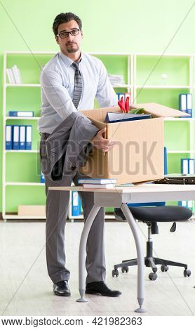 Male employee collecting his stuff after redundancy
