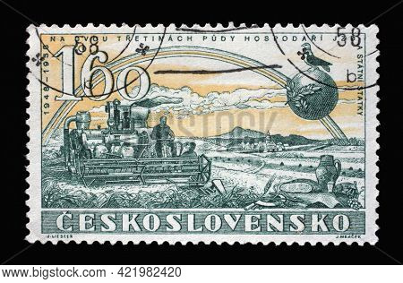 ZAGREB, CROATIA - SEPTEMBER 18, 2014: Stamp printed in Czechoslovakia shows Harvester, Victorious February, 10th Anniversary series, circa 1958