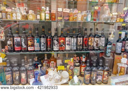 Rome, Italy. Spring 2020. A Liquor Store Window. Wine With Dictators On The Labels. Tourist Showcase