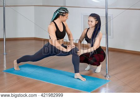 Lesson In Gym Of Pole Dance Studio, Trainer Instructor Helps An Athlete To Do Stretching Exercise.