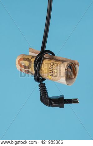 A Fifty Euro Bill Is Inserted Into A Knotted Knot Of A Power Cable With A Plug. Close-up. Blue Color