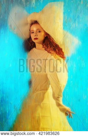 Sophisticated fashion model girl with lush red curly hair posing in a white haute couture dress and a huge bow. Studio portrait. Fashion art. Vintage style.