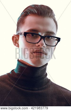 Business style. Portrait of a handsome serious man in modern glasses. Men's accessories, optics. Glasses style.