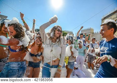 Minsk. Belarus - June 2016: Foam Entertaining Party, People Cheerfully Raise Their Hands, Catch Soap