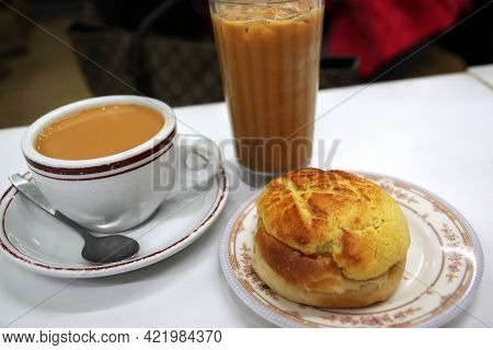Popular Cantonese Breakfast Or Tea Time Favorite Snack Consisting Of Pineapple Bun And Hong Kong Sty
