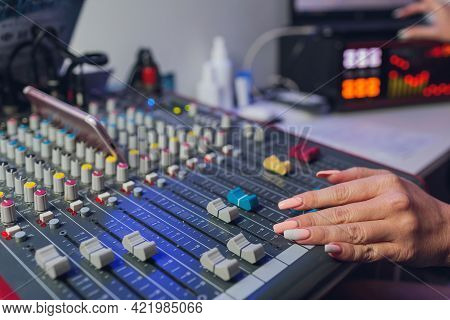 The Djs Hand On The Mixer. Dj On The Turntables. Hand On A Mixer Close-up. Girl Dj At The Mixer Remo