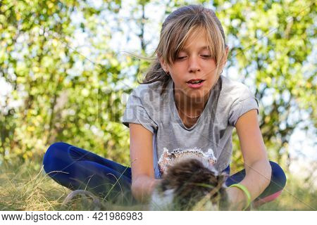 Defocus Blonde Little Expression Girl Playing And Caress Cat, Black And White Small Kitten. Nature B
