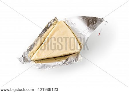 Foil Wrapped Processed Creame Cheese Slice Isolated On A White Background. Small Triangular Piece Of