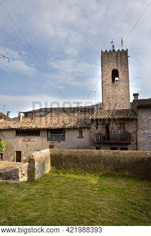 Santa Pau, Spain, May 1, 2020 - Medieval Tower Of Old Picturesque Catalan Town. Welcome To Catalonia