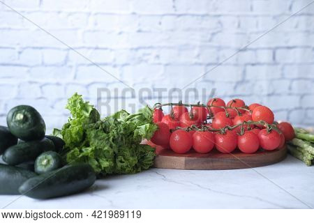 Jalapeno Peppers , Asparagus, Cherry Tomato, Lettuce On Chopping Board