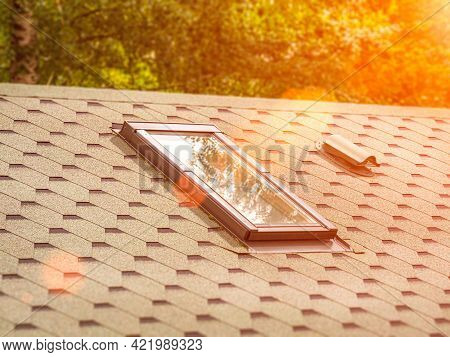 Soft Tiles House Roof With Skylight Window And Ventilation. Solar Lighting And Ventilation Of The At