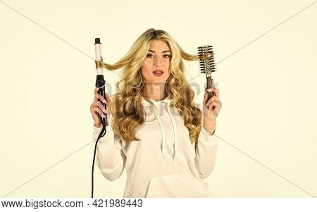 Never Give Up On Your Hair. Girl With Gorgeous Healthy Smooth Hair Using Curler For Perfect Curls. G