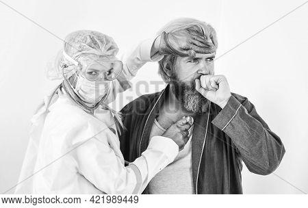Diagnosis Of Pneumonia. Doctor Protective Equipment Examines Patient Suspected Coronavirus Infection