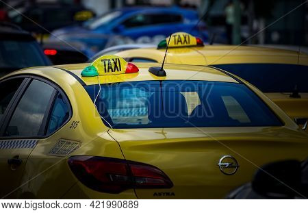 Bucharest, Romania - May 27, 2021: Taxi Cab In Traffic On A Boulevard In Bucharest.