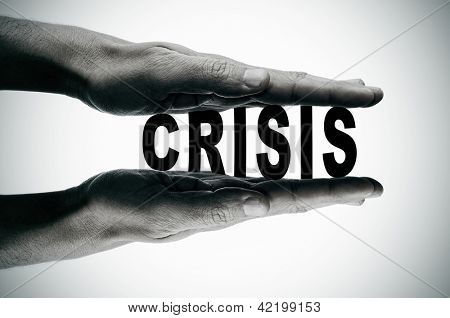 man hands pressing the word crisis, in black and white