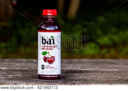 Bottle with Bai antioxidant infusion Zambia Bing Cherry drink outside on table