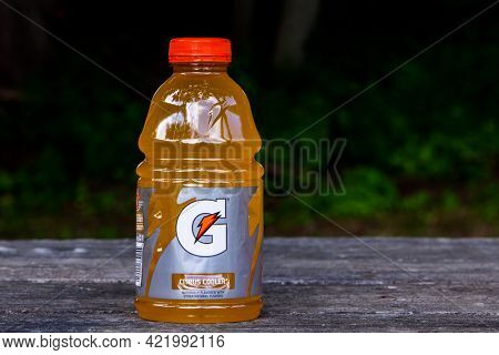 Bottle with Gatoreade citrus cooler drink on table